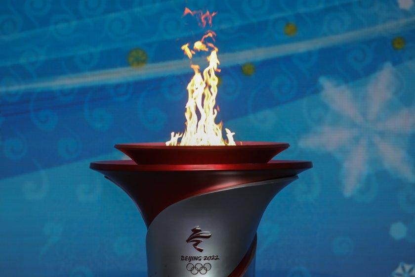 Олимпийският огън пристигна в Китай (Снимки)