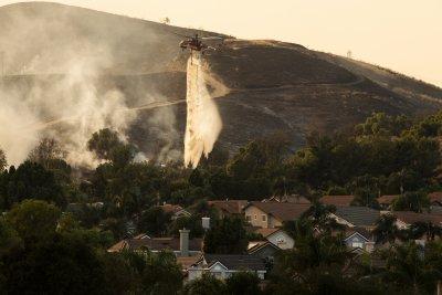 Пожари в Калифорния, ураганът Енрике бушува в Мексико