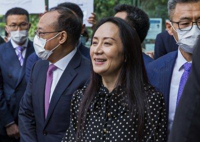 """Дъщерята на основателя на """"Хуауей"""" се върна в Китай"""