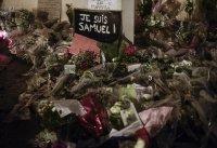Мълчалив марш в памет на убития учител във Франция