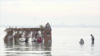 Плуваща сцена на Рождество в лагуната на Венеция