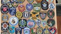 снимка 4 Полицай събира фуражки от цял свят, подреди изложба